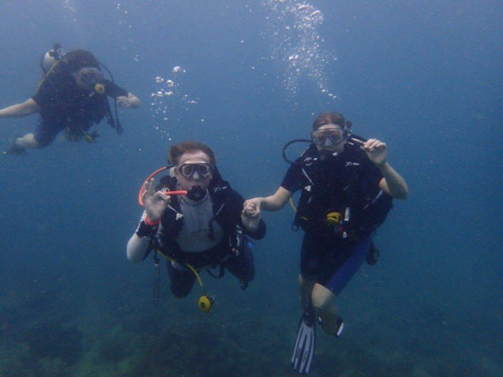 girl diving with instructor